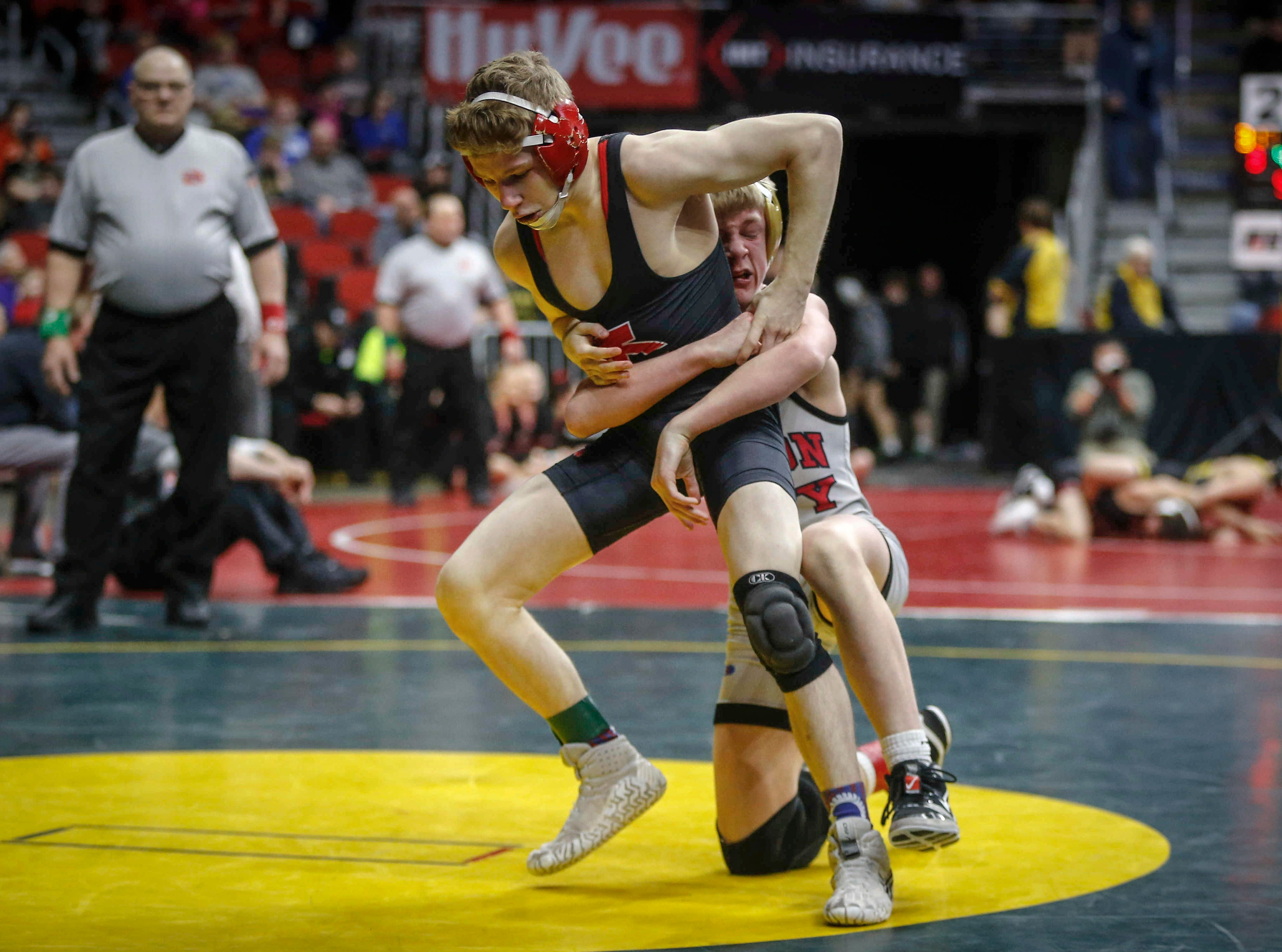 Iowa City High's Ethan Wood-Finley tries to break free from Mason City's Jace Rhodes in their match at 106 pounds during the state wrestling quarterfinals on Friday, Feb. 15, 2019, at Wells Fargo Arena in Des Moines.