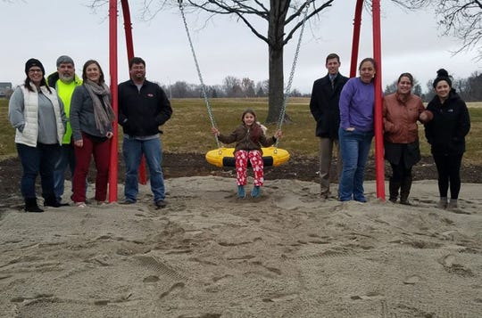 Carlisle Hometown Pride gathers to celebrate the saucer swing installed in December in the South Lindhardt Park.