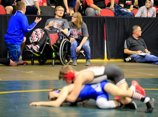 Lincoln Coakley, 18, and a former wrestler for Estherville-LIncoln Central watches the state wrestling tournament Thursday, Feb. 14, 2019. He is recovering from a car accident in June that left him in a coma.