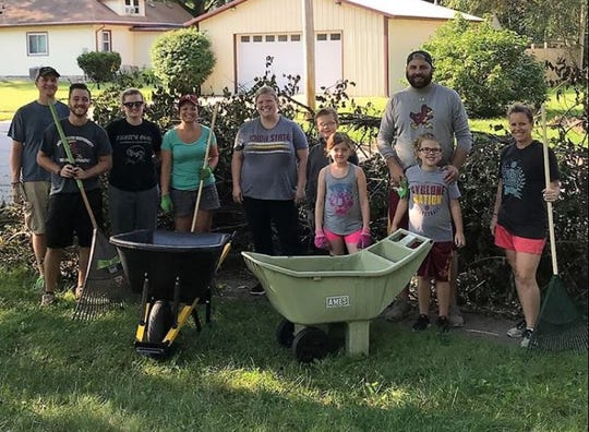Indianola residents help out on clean-up day for the 2018 Indianola Hometown Pride.