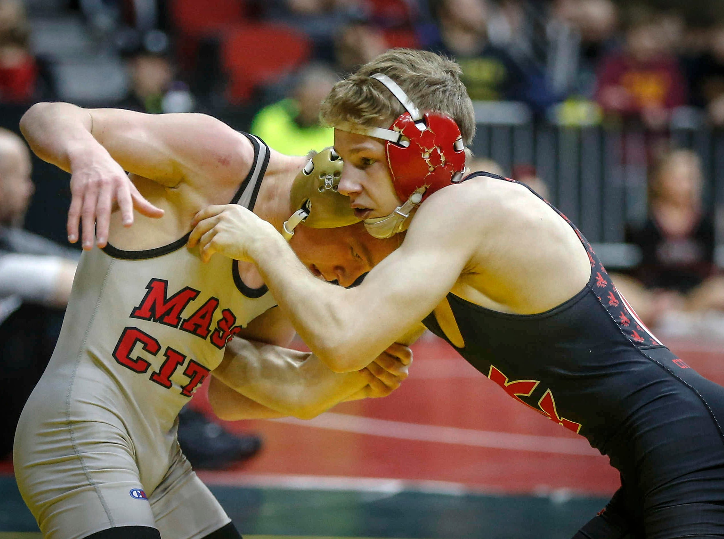 Iowa City High's Ethan Wood-Finley, right, battles Mason City's Jace Rhodes in their match at 106 pounds during the state wrestling quarterfinals on Friday, Feb. 15, 2019, at Wells Fargo Arena in Des Moines.