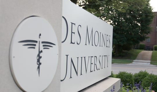 Neighbors are fighting Des Moines University's plans to add 45 parking spaces on the school's campus over worries about flooding.