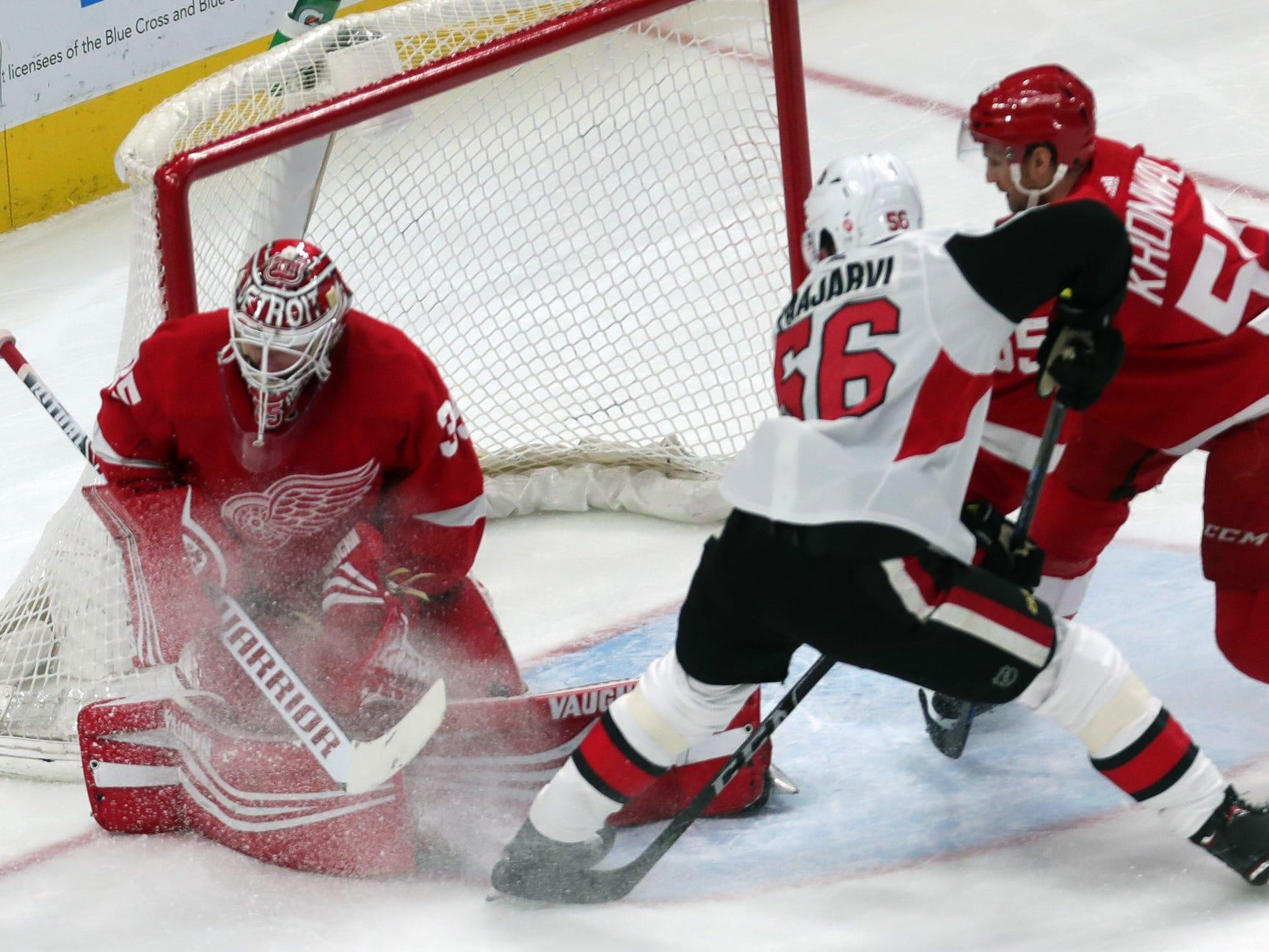 Detroit Red Wings goalie Jimmy Howard, left, makes a save against Senators left wing Magnus Paajarvi on Thursday, FEb. 14, 2019, in Detroit.