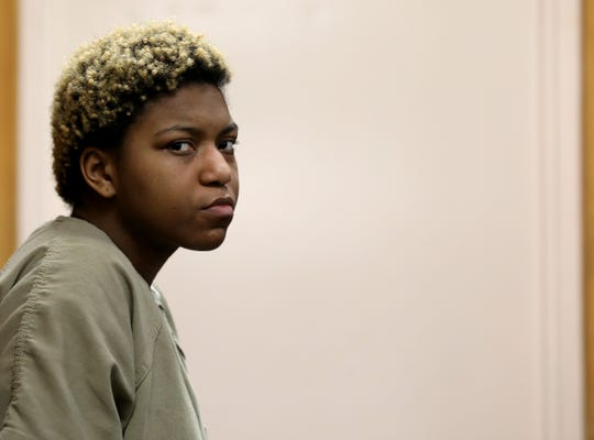 Tanaya Lewis waits during a pause in her preliminary exam Feb. 15 in 37th District Court in Warren.
