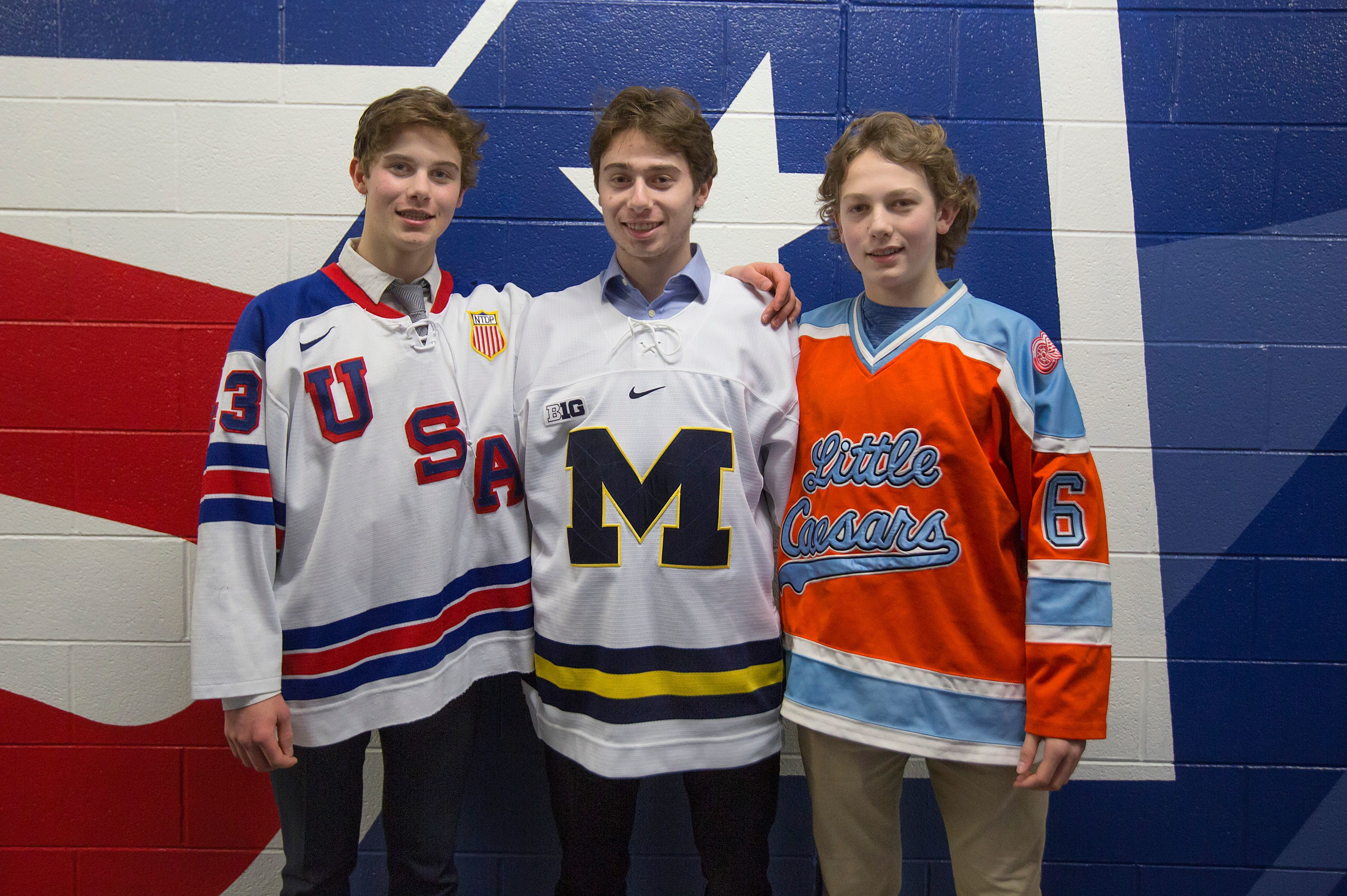 The Hughes brothers are shown in a 2019 photo at USA Hockey Arena in Plymouth, Mich. Forward Jack Hughes (left) now plays for the Devils and will be joined defenseman Luke (right), after New Jersey selected the latter No. 4 overall in the 2021 NHL Draft. Quinn Hughes (center) is currently a defenseman for the Vancouver Canucks.