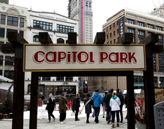 A tour group passes through the part area of Capitol Park in downtown Detroit as seen on Thursday, February 14, 2019.