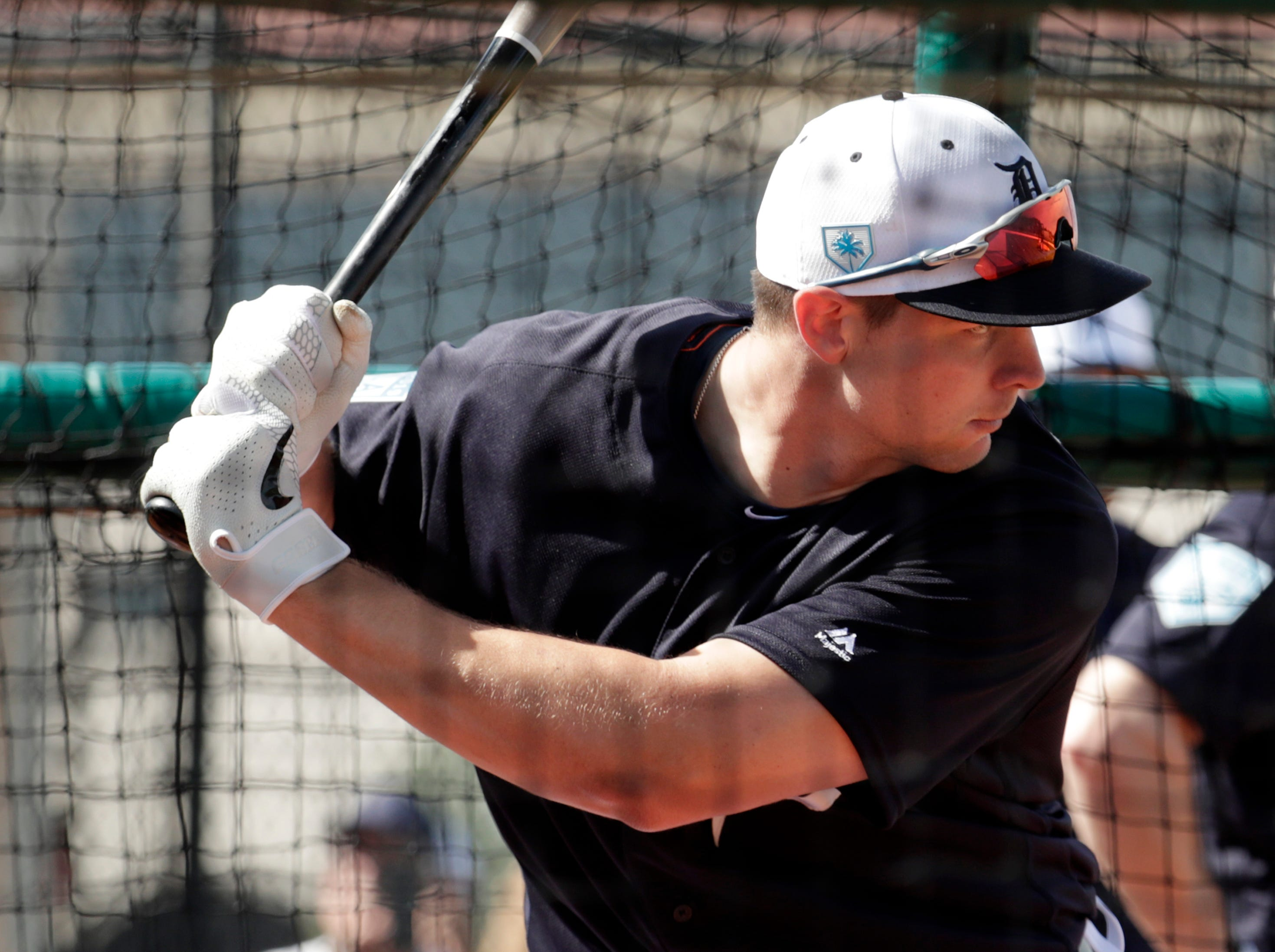 Detroit Tigers catcher Grayson Greiner bats at the Detroit Tigers spring training baseball facility, Friday, Feb. 15, 2019, in Lakeland, Fla.