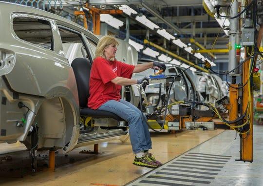 General Motors assembly team member LeAnn Franke uses the