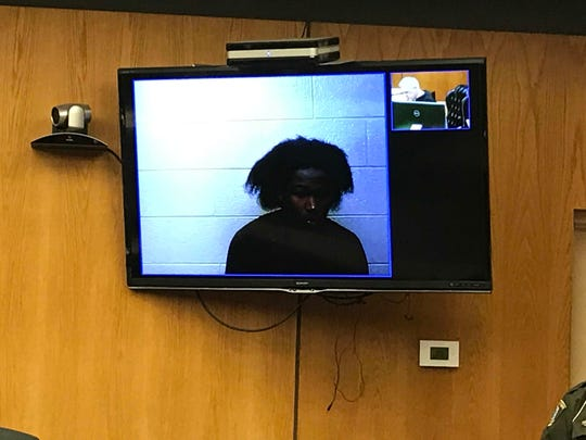 William Davis is arraigned Feb. 15 in Warren District Court on charges connected to the hit-and-run death of a Roseville bicyclist Feb. 3.