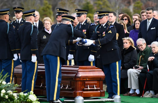 Rep. Debbie Dingell, (D-MI) and wife of former Congressman John D. Dingell, a veteran of World War II, during the burial service with honors at Arlington National Cemetery on Feb. 15, 2019.