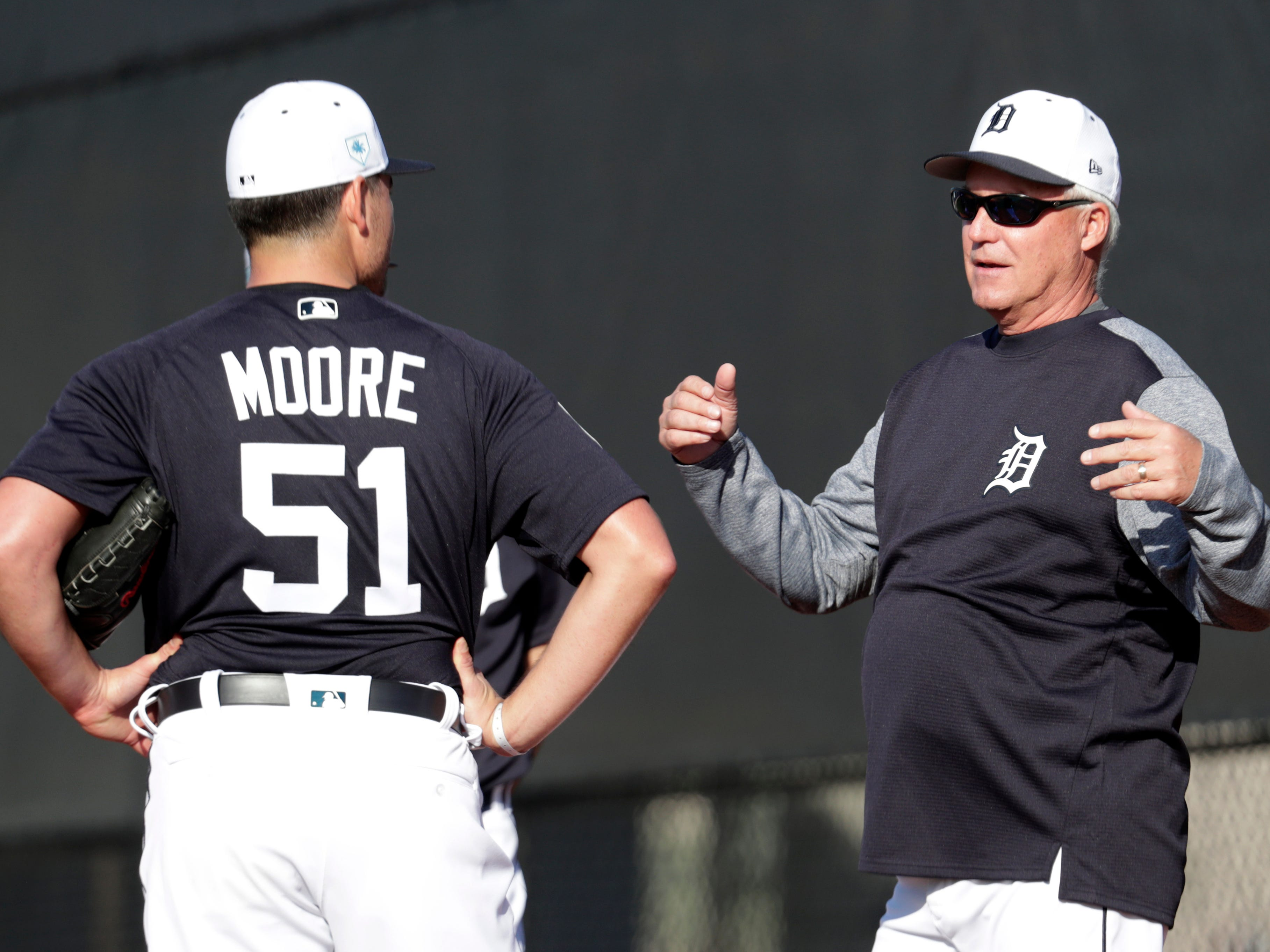 Detroit Tigers pitching coach Rick Anderson, right, talk with pitcher Matt Moore at the Tigers spring training baseball facility, Friday, Feb. 15, 2019, in Lakeland, Fla.