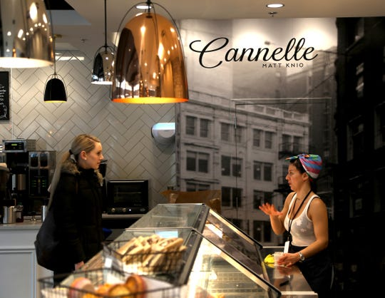 Sienna White, 28, left, who lives in the Griswold Building, talks with Cannelle Patisserie employee Rawaa Knio while shopping for pastries at the recently opened store in Capitol Park in downtown Detroit on Thursday, February 14, 2019.