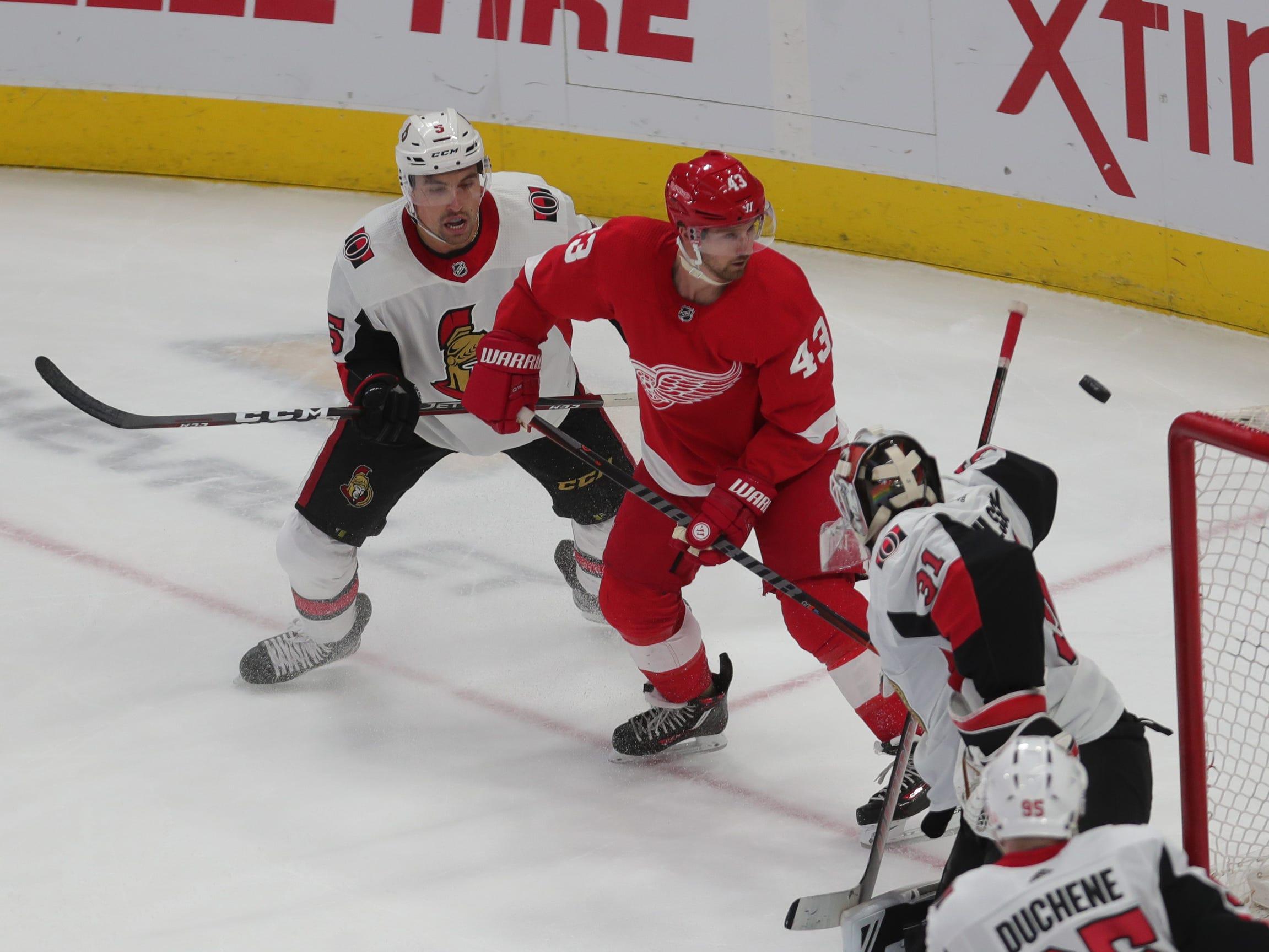 Red Wings forward Darren Helm shoots against Senators goalie Anders Nilsson on Feb. 14, 2019 at Little Caesars Arena in Detroit.