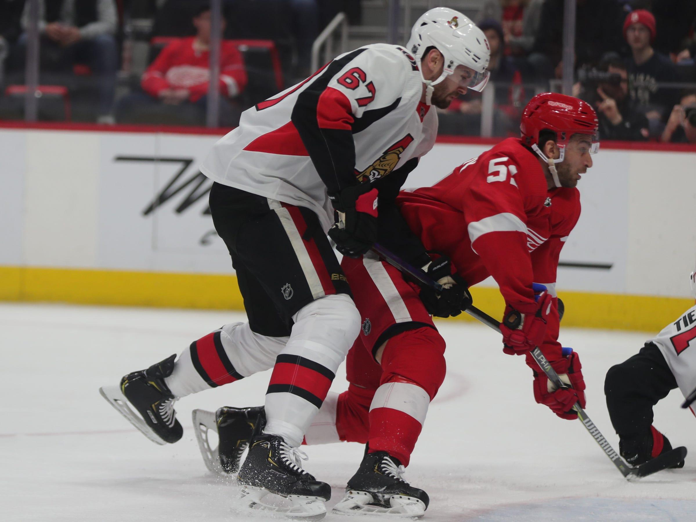 Red Wings defenseman Jonathan Ericsson is checked by Ottawa Senators defenseman Ben Harpur on Feb. 14, 2019 at Little Caesars Arena in Detroit.