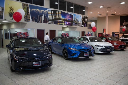Toyota sedans are displayed in a showroom at Puente Hills Toyota Thursday, Feb. 14, 2019, in Industry, Calif.
