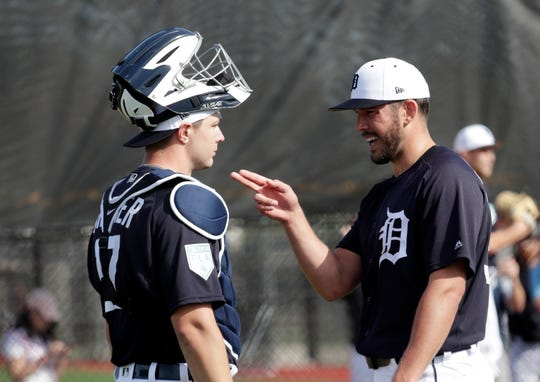 Detroit Tigers pitcher Drew VerHagen, right, talks with catcher Grayson Greiner at the Tigers' spring training baseball facility, Friday, Feb. 15, 2019, in Lakeland, Fla.