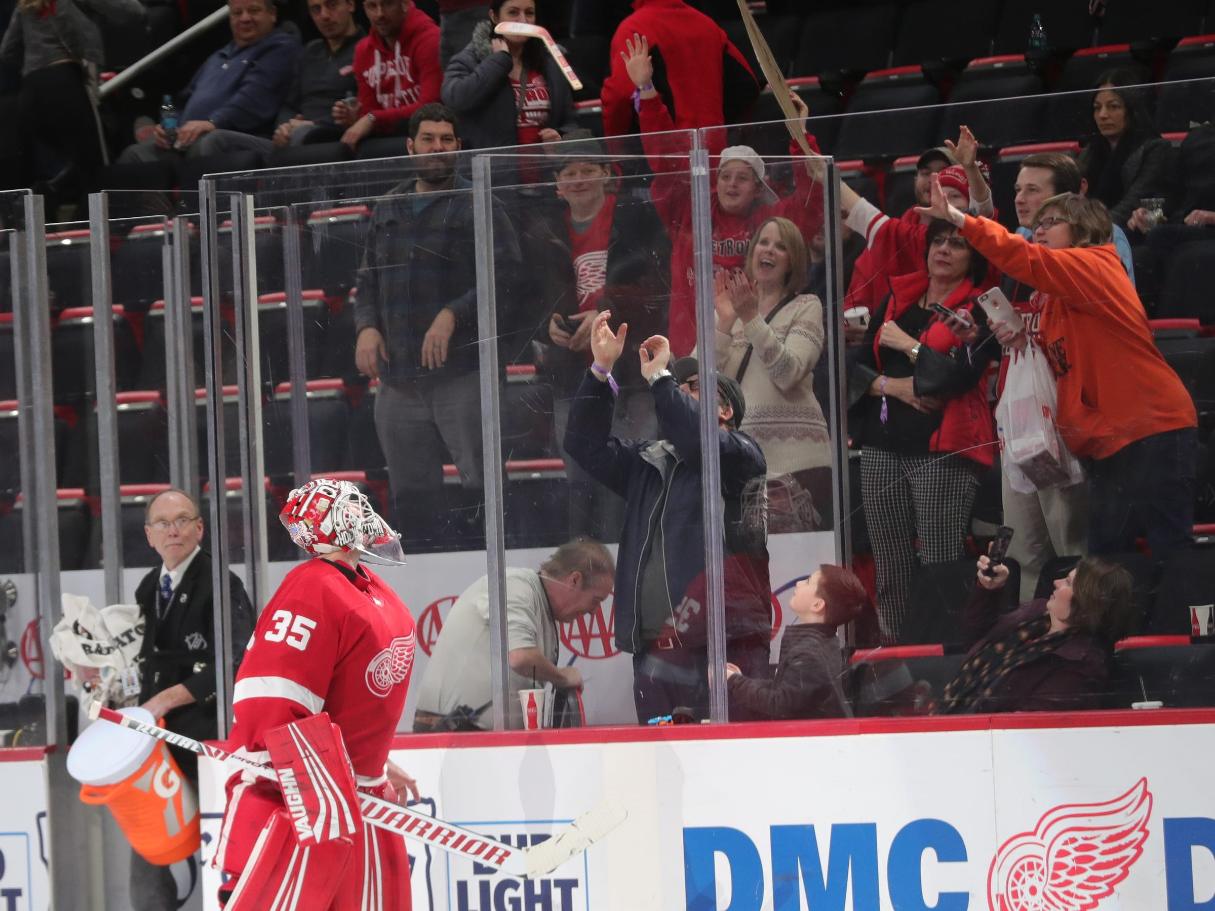 Detroit Red Wings goalie Jimmy Howard thows his stick into the crowd after completing his 500th career game Thursday, Feb. 14, 2019 at Little Caesars Arena in Detroit.