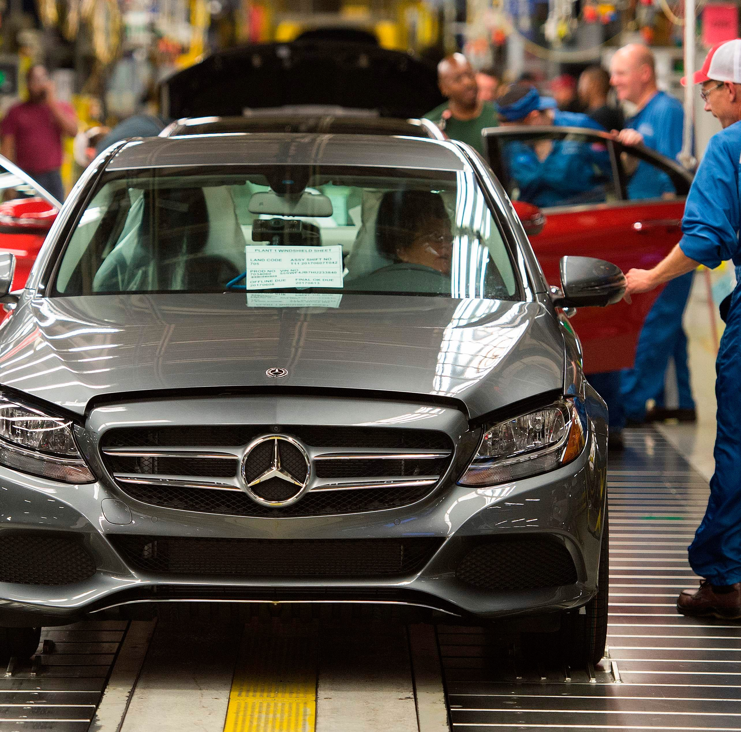"In this file photo taken on June 8, 2017 Employees inspect Mercedes-Benz C-Class cars at the Mercedes-Benz US International factory in Vance, Alabama. - A US Commerce Department report has concluded that American auto imports threaten national security, setting the stage for possible tariffs by the White House, two people familiar with the matter said February 14, 2019. The investigation, ordered by President Donald Trump in May, is ""positive"" with respect to the central question of whether the imports ""impair"" US national security, said a European auto industry source."