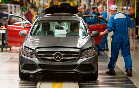 Employees inspect Mercedes-Benz C-Class cars at the Mercedes-Benz US International factory in Vance, Alabama.