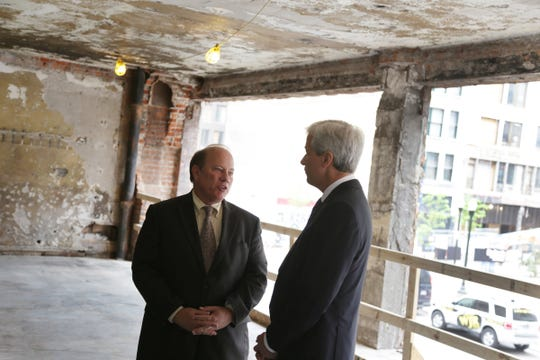 Detroit mayor Mike Duggan, left and JPMorgan Chase CEO Jamie Dimon talk after a ceremony marking the start of renovation at 1145 Griswold in Capitol Park in Detroit on Monday, May 18, 2015.