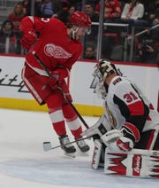 Red Wings forward Michael Rasmussen shoots against Ottawa Senators goalie Anders Nilsson during first period action Thursday at Little Caesars Arena.