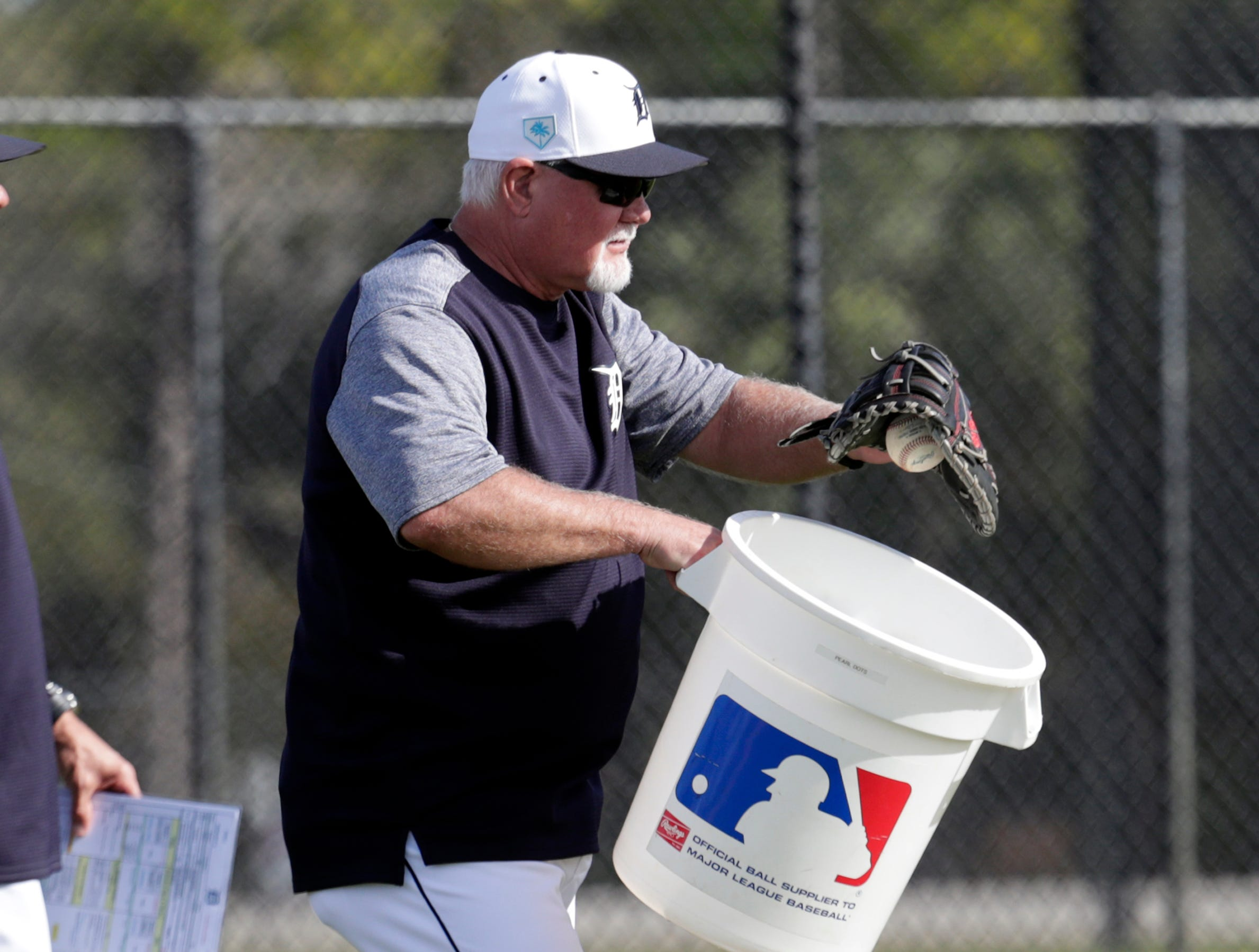 Detroit Tigers manager Ron Gardenhire collects balls as players do drills at the Detroit Tigers spring training baseball facility, Friday, Feb. 15, 2019, in Lakeland, Fla.