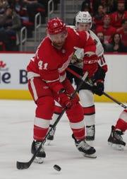 Detroit Red Wings forward Luke Glendening is defended by Ottawa Senators' Thomas Chabot on Thursday, Feb. 14, 2019, at Little Caesars Arena in Detroit.