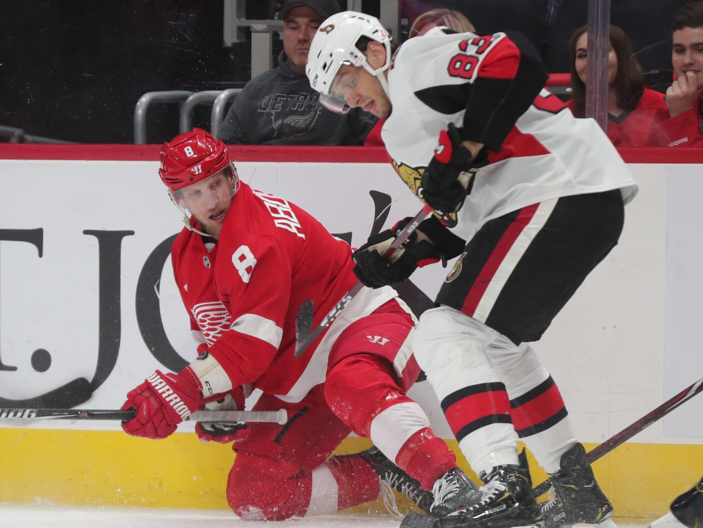 Detroit Red Wings forward Justin Ablelkader goes for the puck against Ottawa Senators defenseman Christian Jaros during on Thursday, Feb. 14, 2019, in Detroit.