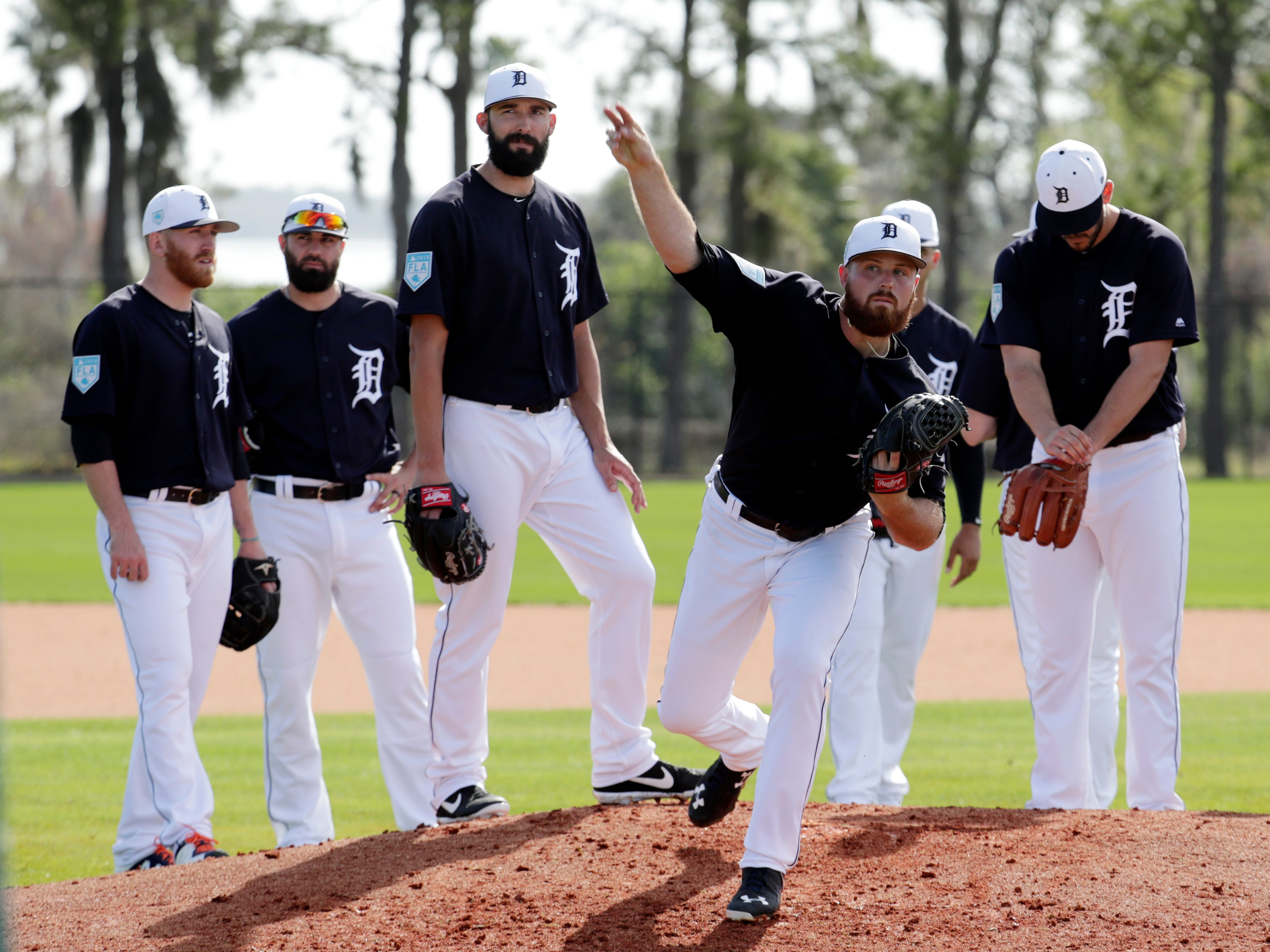 Detroit Tigers relief pitcher Buck Farmer works ona drill at the Tigers spring training baseball facility, Friday, Feb. 15, 2019, in Lakeland, Fla.