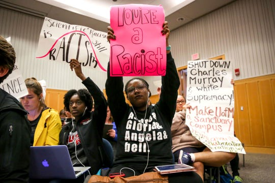 Students protest during an Oct. 11, 2017  speech by author Charles Murray, who co-wrote a book discussing racial differences in intelligence, at Palmer Commons at the University of Michigan, in Ann Arbor.