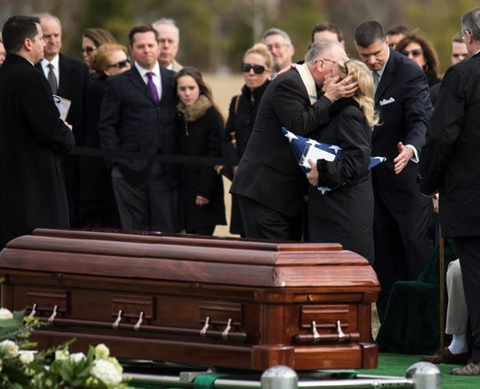 Rep. Debbie Dingell, D-Mich., is hugged by Patrick Conroy, the chaplain of the House of Representatives, during the burial services of her husband, former Rep. John Dingell, D-Mich., at Arlington National Cemetery in Arlington, Va., Friday.