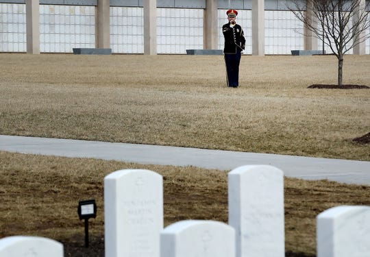 A bugler plays taps during the funeral service for former Rep. John Dingell (at Arlington National Cemetery Friday in Arlington, Virginia. Rep. Dingell, the longest-serving member of the House of Representatives, representing Michigan's 12th, 15th and 16th districts between 1955 and 2015, passed away on Feb 7, 2019 at the age of 92.