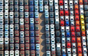 Cars are parked waiting to be exported at Yokohama port near Tokyo.