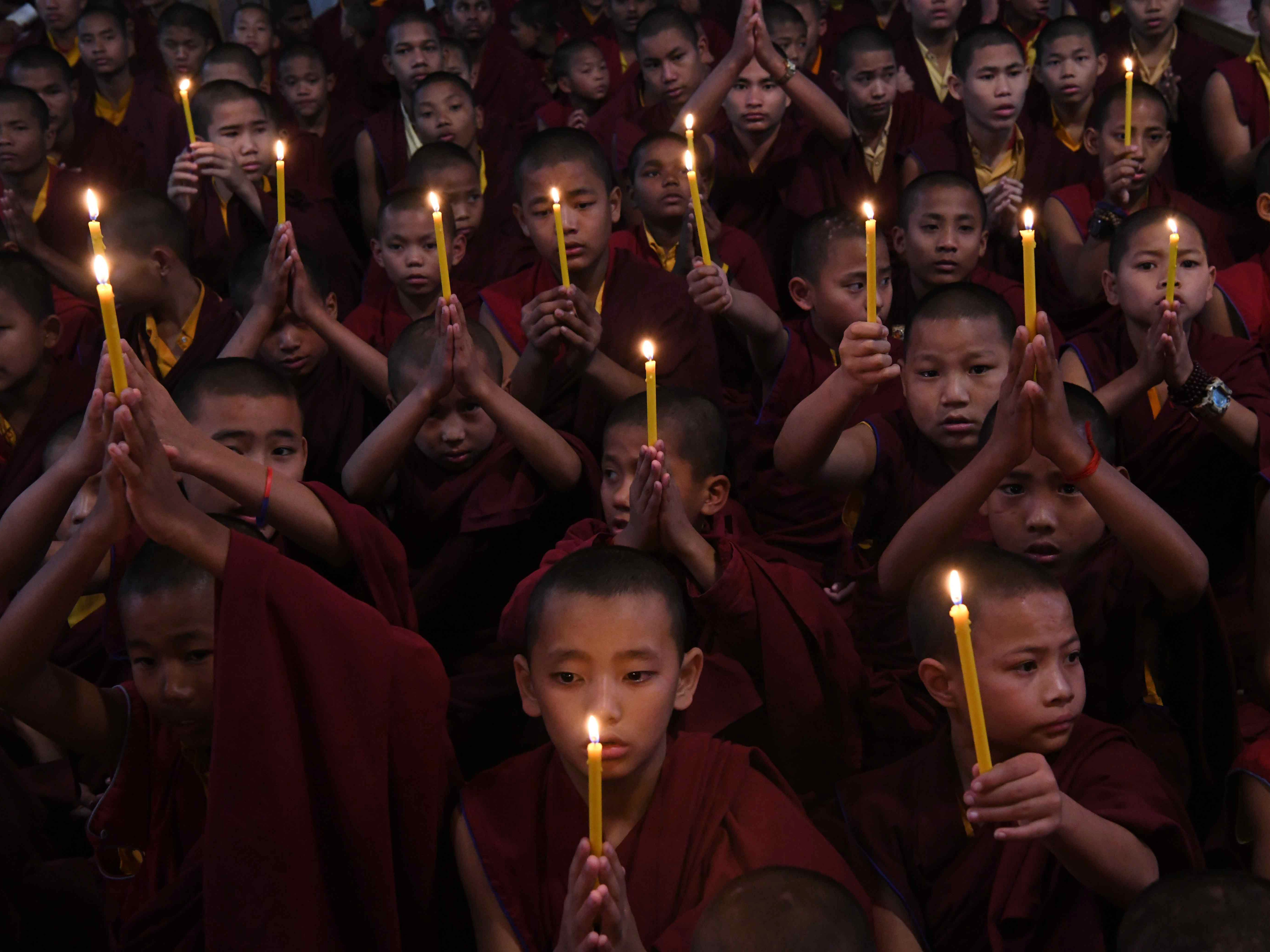 Novice Buddhist monks offer prayers at Tergar monastery in Bodhgaya in the Indian state of Bihar on Feb. 15, 2019, the day after an attack on a paramilitary Central Reserve Police Force (CRPF) convoy in the Lethpora area of Kashmir. India and Pakistan's troubled ties risked taking a dangerous new turn on Feb. 15 as New Delhi accused Islamabad of harboring militants behind the deadliest bombing in three decades of bloodshed in Indian-administered Kashmir. At least 41 paramilitary troops were killed on February 14 as explosives packed in a van ripped through a convoy bringing 2,500 troopers back from leave not far from the main city Srinagar.