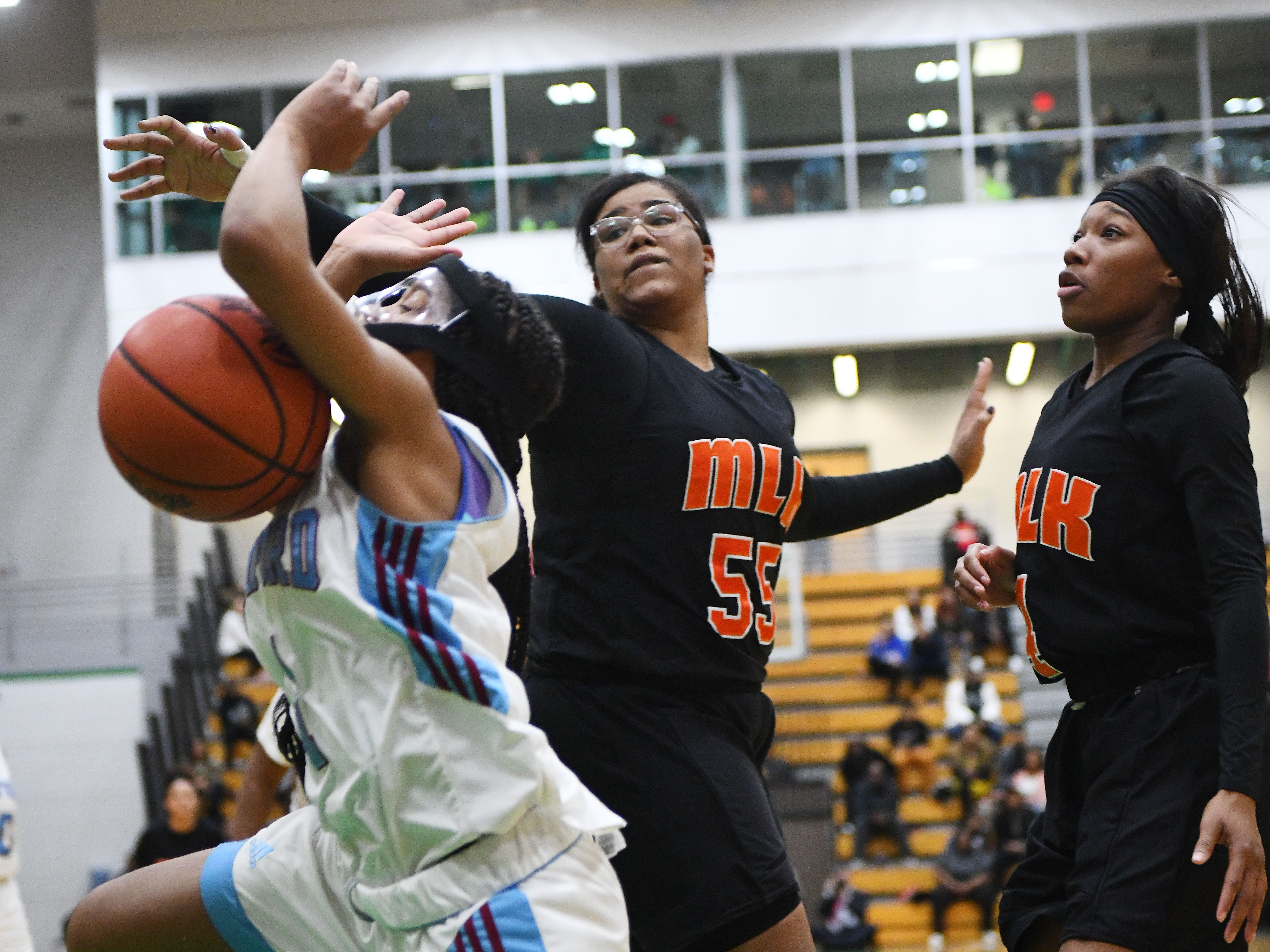 Mumford's Jaquoia Jackson is fouled by King's Erica Martin in the first half.