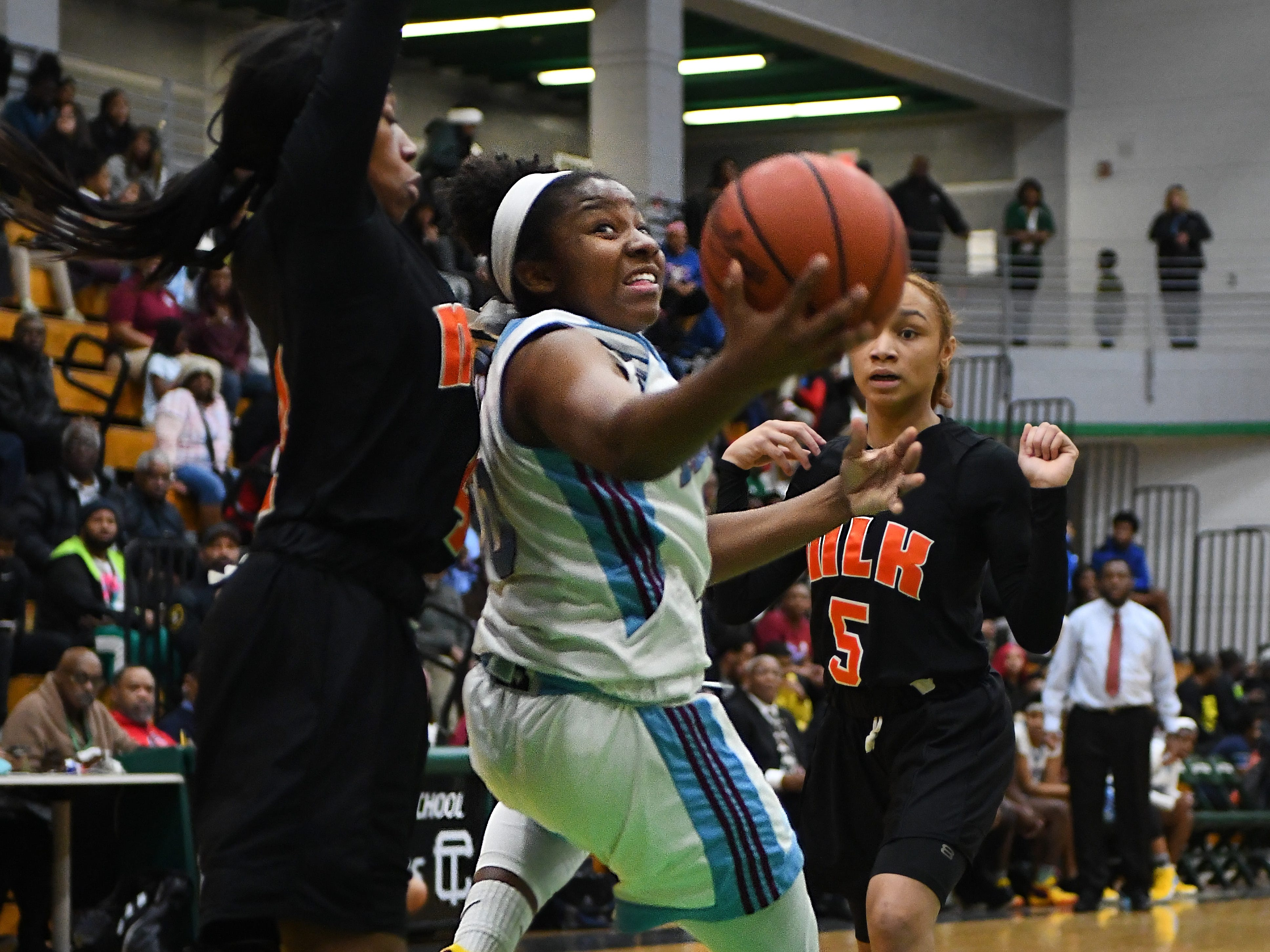 Mumford's Andoreya Williams gets fouled by King's Del'Janae Williams trying to lay up a shot backwards in the first half.