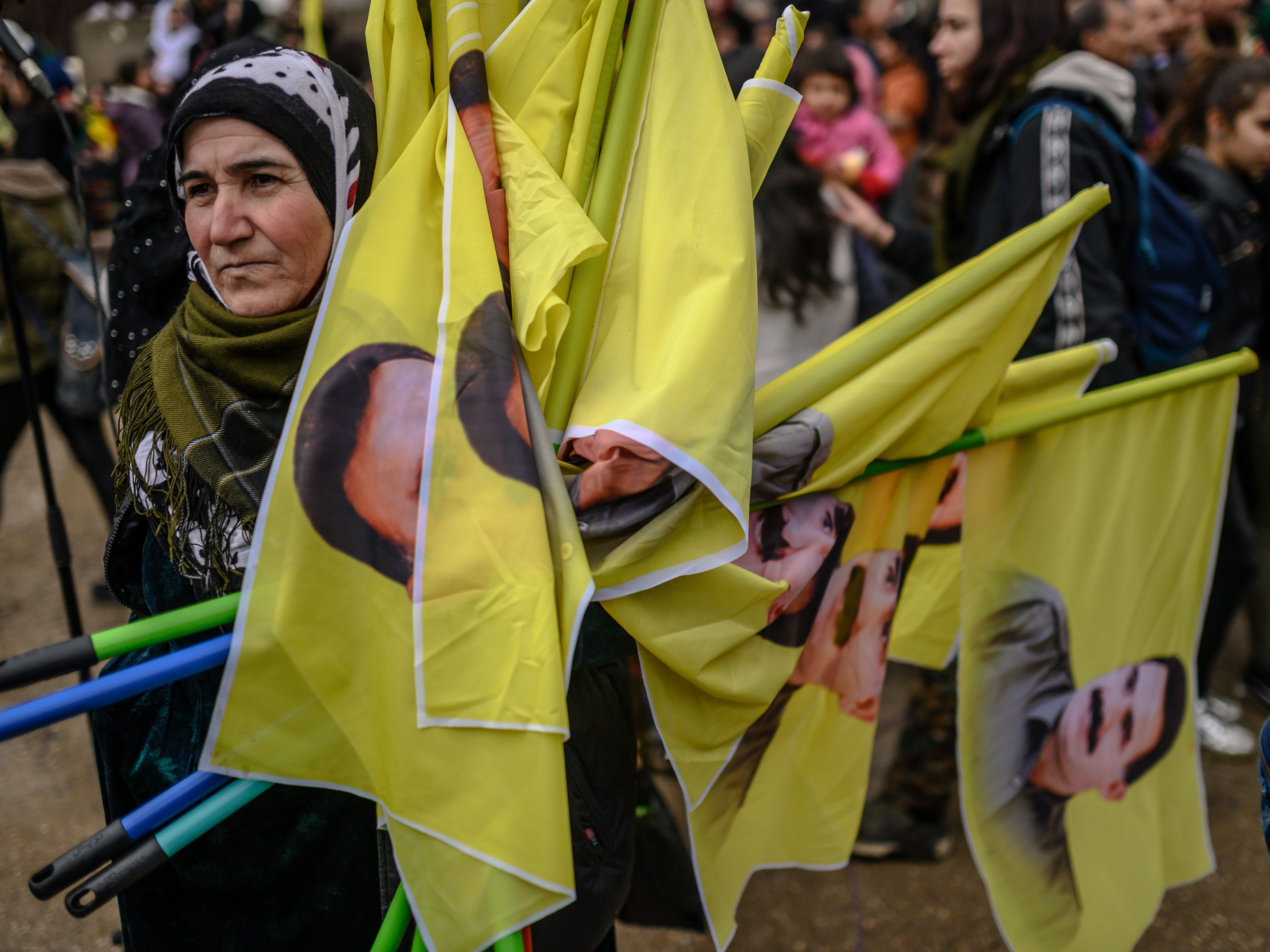 A woman holds portrait of jailed Kurdish militant leader Abdullah Ocalan during a rally in his support, on Feb. 15, 2019, in the northeastern Syrian Kurdish-majority city of Qamishli. Ocalan, arrested 20 years ago, is serving a life sentence on Imrali island, close to Istanbul. mages)