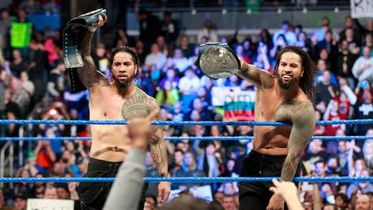 Jimmy Uso, left, was arrested in Detroit late Thursday evening.