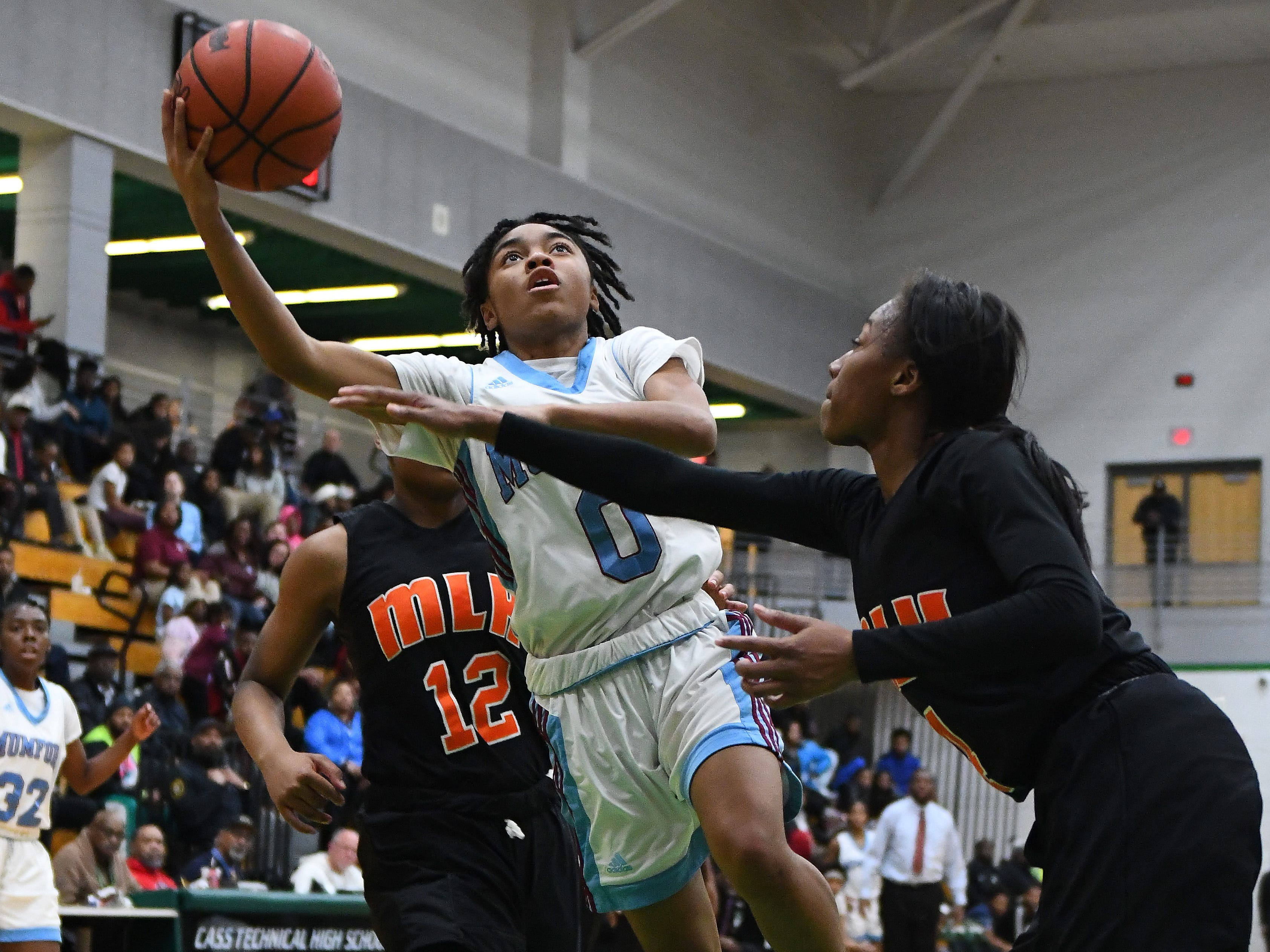 Mumford's Nakila Wright splits the defense and lays up two points in the first half.