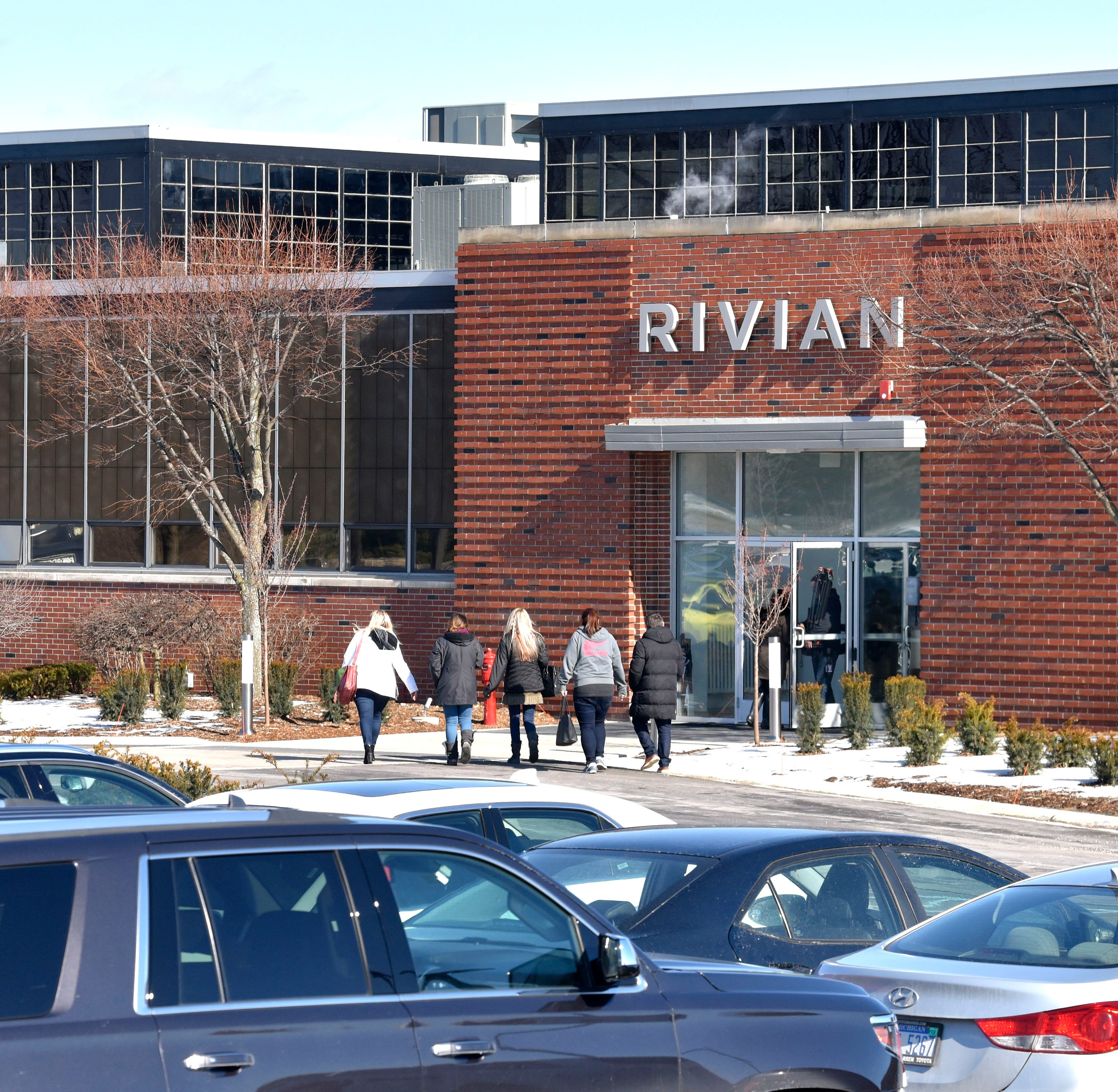 Electric pickup maker Rivian gets $700M from Amazon, others