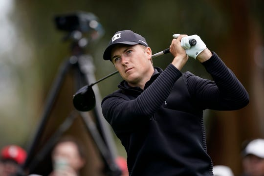Jordan Spieth watches his tee shot on the 11th hole during the first round of the Genesis Open.