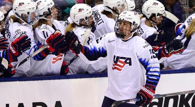 U.S. forward Alex Carpenter, right, celebrates with teammates after scoring against Canada on Thursday in Toronto.