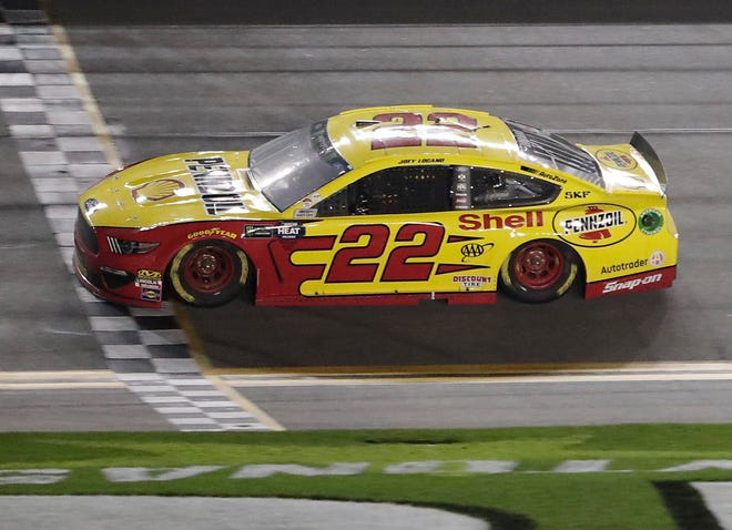 Joey Logano (22) crosses the finish line to win the second of two qualifying auto races for the NASCAR Daytona 500.