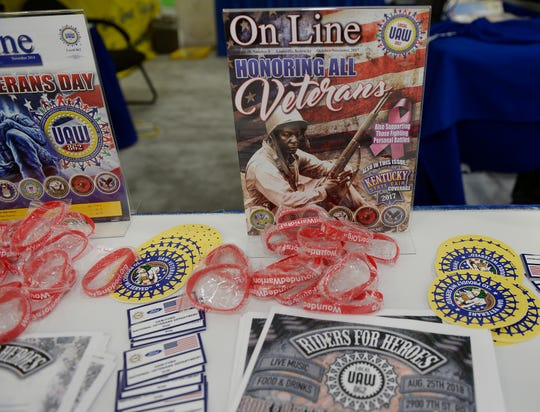 A vendor table with free items distributed at the UAW Constitutional Convention at Cobo Center in June 2018 (Clarence Tabb Jr./The Detroit News)