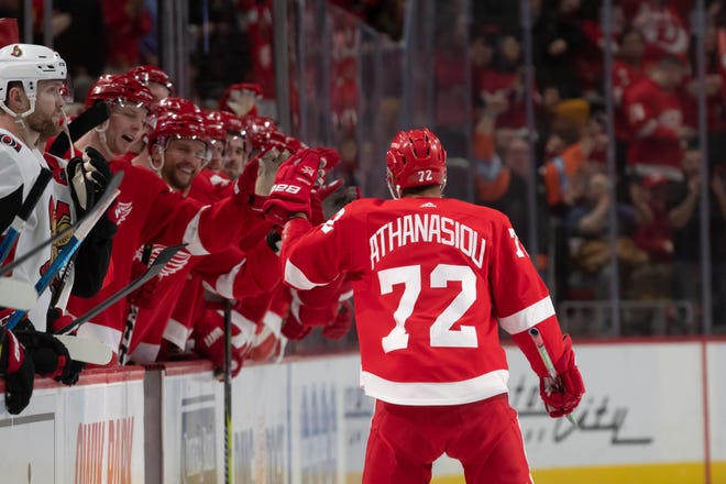 Detroit center Andreas Athanasiou celebrates with his teammates after scoring on a penalty shot in the first period.