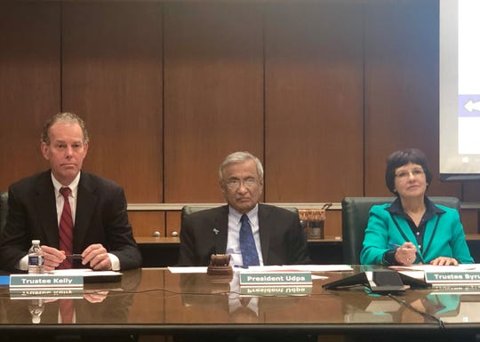 Acting Michigan State University President Satish Udpa (center), flanked by Trustees Dan Kelly and Dianne Byrum.