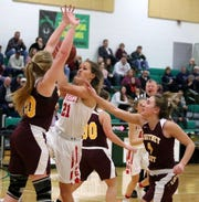 Wendi Hammond of Waverly drives to the basket as Ashley Barnhart, left, and Amy Stevens of Whitney Point defend during the IAC Large School girls basketball championship game Feb. 14, 2019 at Tompkins Cortland Community College.