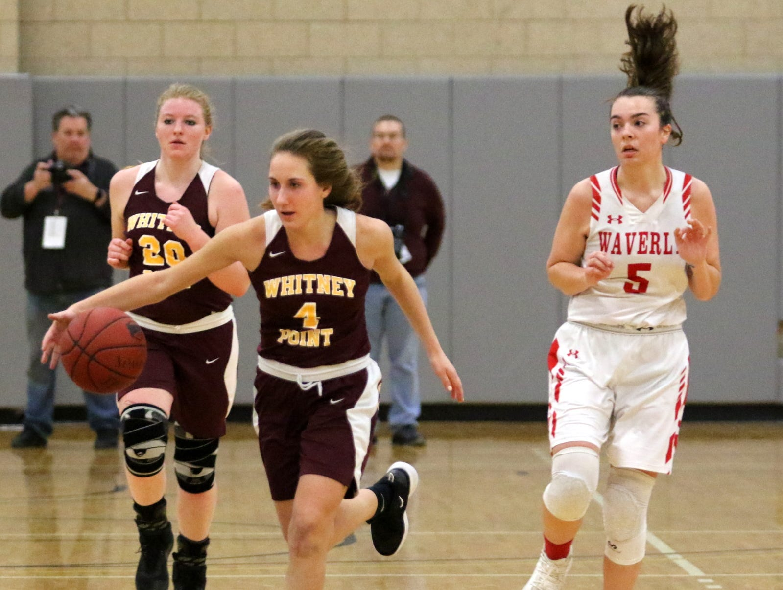Action from the IAC Large School girls basketball championship game between Waverly and Whitney Point on Feb. 14, 2019 at Tompkins Cortland Community College.