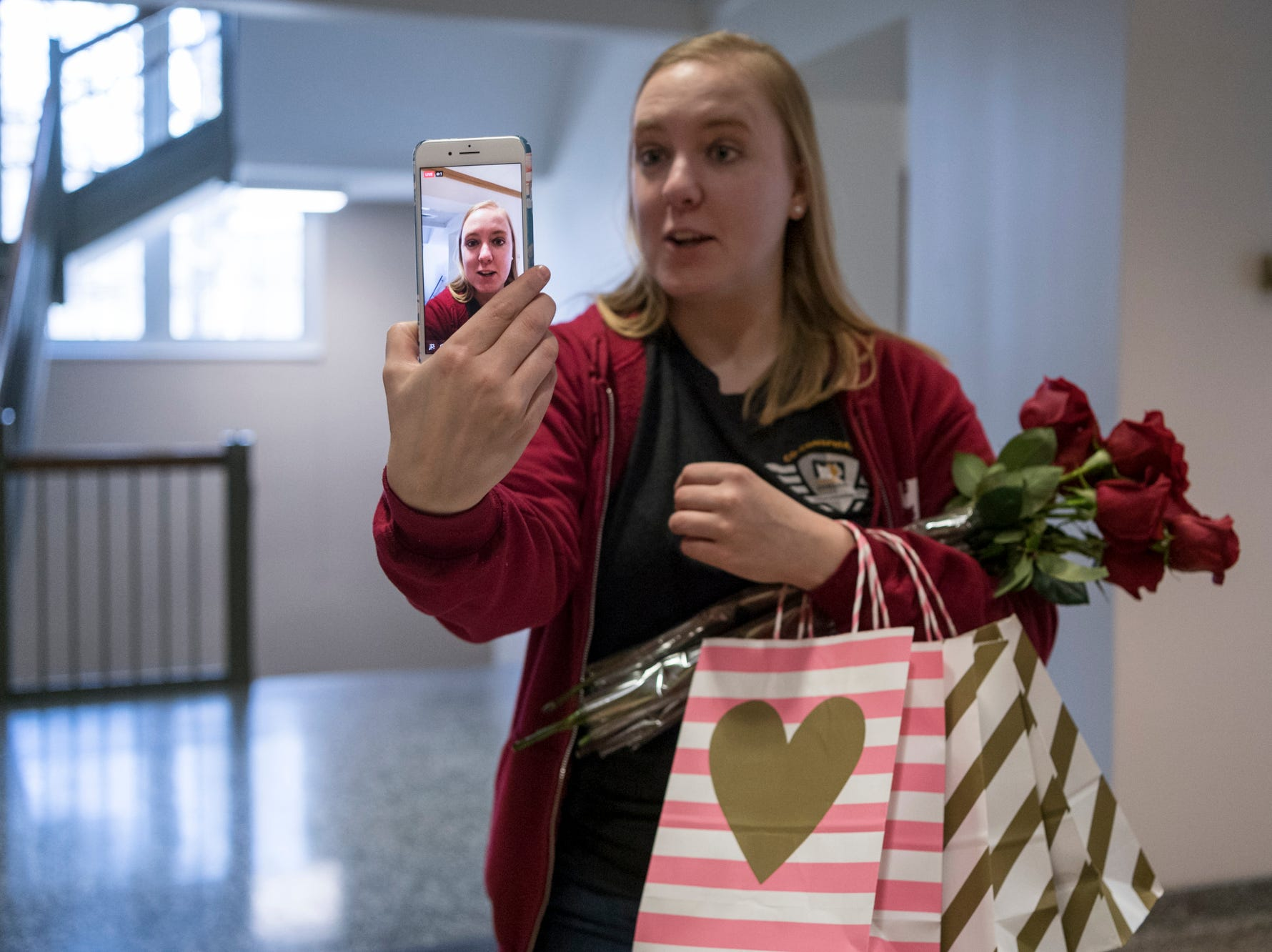 Amanda Coburn begins to livestream her Cuddlegram delivery of three kittens to the Vanderburgh Humane Society Facebook page at the University of Evansville's Schroeder School of Business in Evansville, Ind., Thursday afternoon, Feb. 14, 2019. VHS raised over $3,000 through the second annual fundraiser.