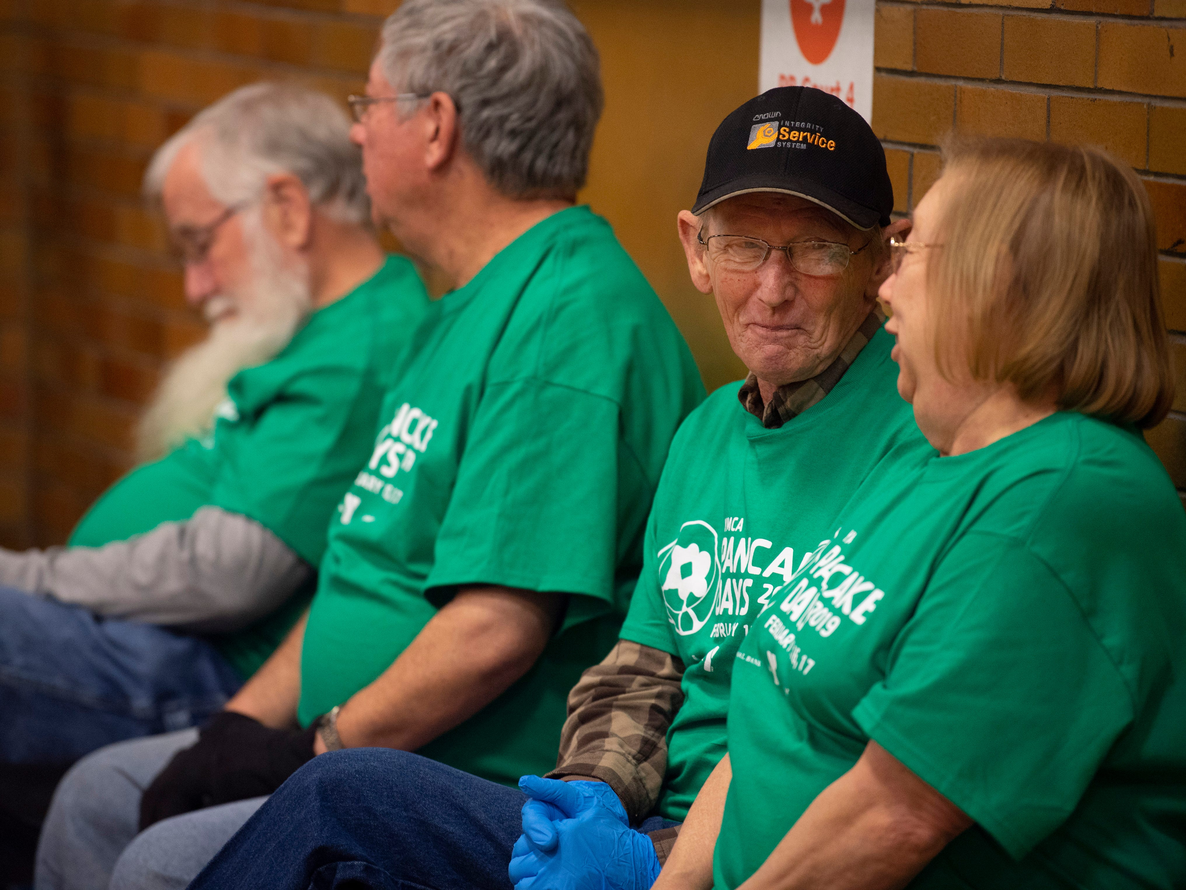 Eddie and Marilyn Pennington, right, take a break from serving coffee at the 31st Annual Pancake Days at the Downtown YMCA Friday morning. The pancakes, sausage, milk, coffee and orange juice will be served up again Saturday from 6 a.m. to 1 p.m. and Sunday from 8 a.m. to 1 p.m.